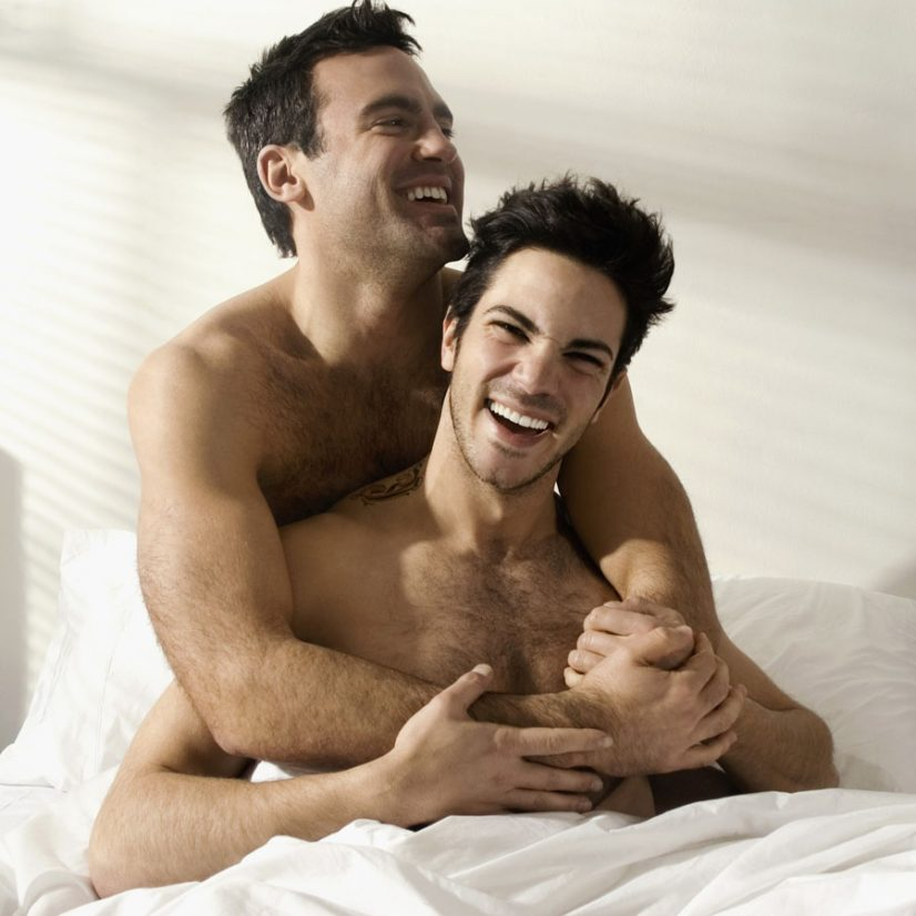 Photo of Gay Men on Bed